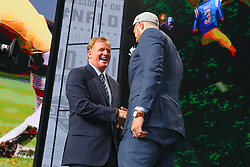 April 26, 2018 - Arlington, TX, U.S. - ARLINGTON, TX - APRIL 26:  Kolton Miller shakes hands with NFL Commissioner Roger Goodell after being chosen by the Oakland Raiders with the fifteenth pick during the first round at the 2018 NFL Draft at AT&T Statium on April 26, 2018 at AT&T Stadium in Arlington Texas.  (Photo by Rich Graessle/Icon Sportswire) (Credit Image: © Rich Graessle/Icon SMI via ZUMA Press)