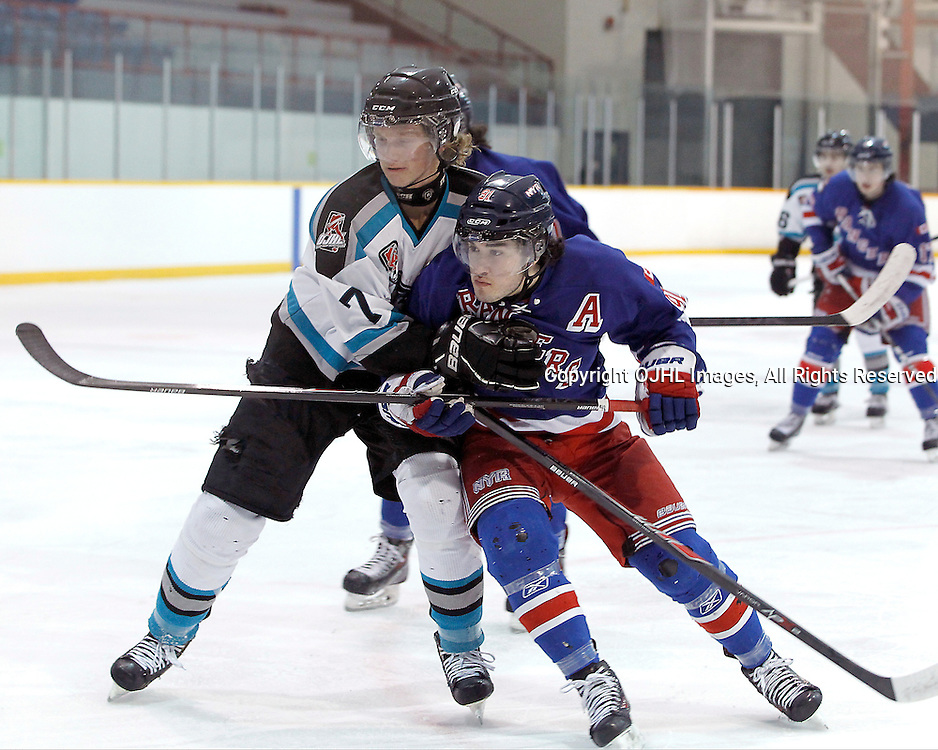 Lindsay, ON - Jan 31 : Ontario Junior Hockey League game action between the Lindsay Muskies and the North York Rangers. James Sterne #7 of the Lindsay Muskies Hockey Club battles for the puck with John Carpino #91 of the North York Rangers Hockey Club.<br /> (Photo by Tim Bates / OJHL Images)