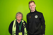 Forest Green Rovers Nathan McGinley(19) with his sponsor during the EFL Sky Bet League 2 match between Forest Green Rovers and Carlisle United at the New Lawn, Forest Green, United Kingdom on 16 March 2019.