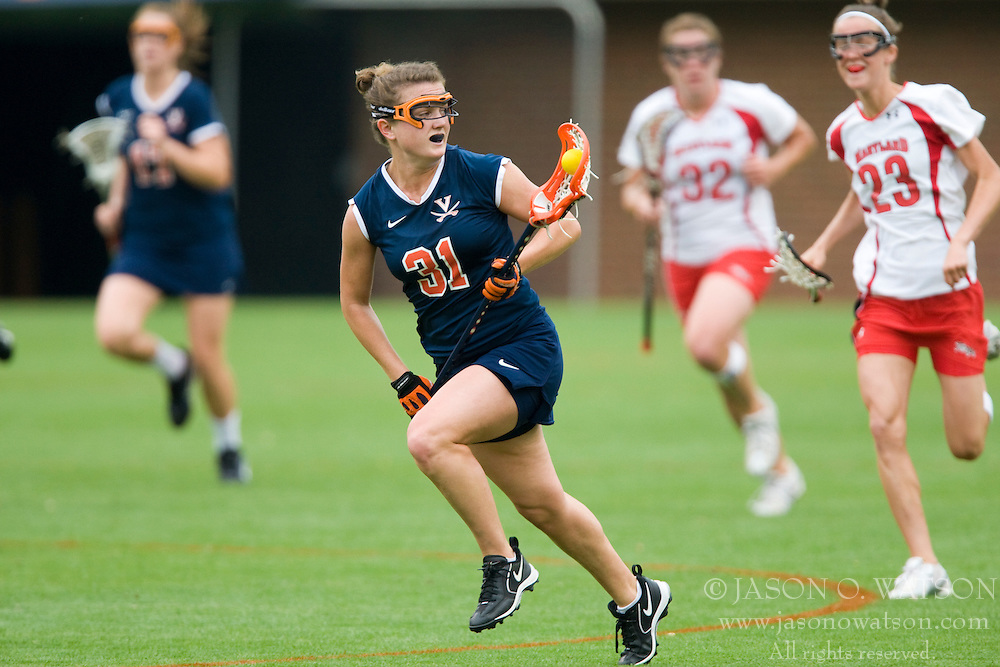 Virginia Cavaliers A Jenny Hauser (31) clears the ball upfield against Maryland.  The #3 ranked Virginia Cavaliers defeated the #2 ranked Maryland Terrapins 10-9 in overtime in the finals of the Women's 2008 Atlantic Coast Conference Lacrosse tournament at the University of Virginia's Scott Stadium in Charlottesville, VA on April 27, 2008.