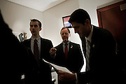 """House Budget Chairman PAUL RYAN (R-WI), (right) listens as his staffer KEVIN SIEFERT preps a group of House Republicans for a news conference to unveil their FY2012 budget resolution they are calling """"Path to Prosperity.'"""