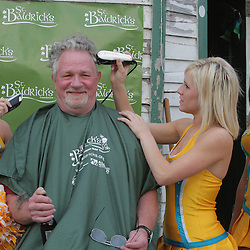 12 March 2009:  New Orleans Hornets Honeybees NBA dancers help in shaving the head of a participant during the annual St. Baldrick's charity fund raiser held at Parasol's Bar in the Irish Channel of New Orleans, Louisiana.