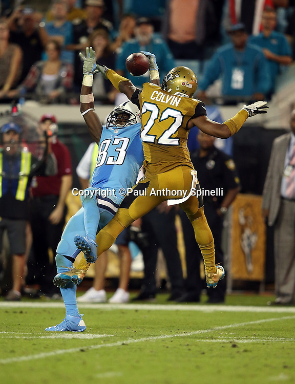 Jacksonville Jaguars cornerback Aaron Colvin (22) leaps as he breaks up a pass intended for Tennessee Titans wide receiver Harry Douglas (83) with 22 seconds left in the fourth quarter during the 2015 week 11 regular season NFL football game against the Tennessee Titans on Thursday, Nov. 19, 2015 in Jacksonville, Fla. The Jaguars won the game 19-13. (©Paul Anthony Spinelli)