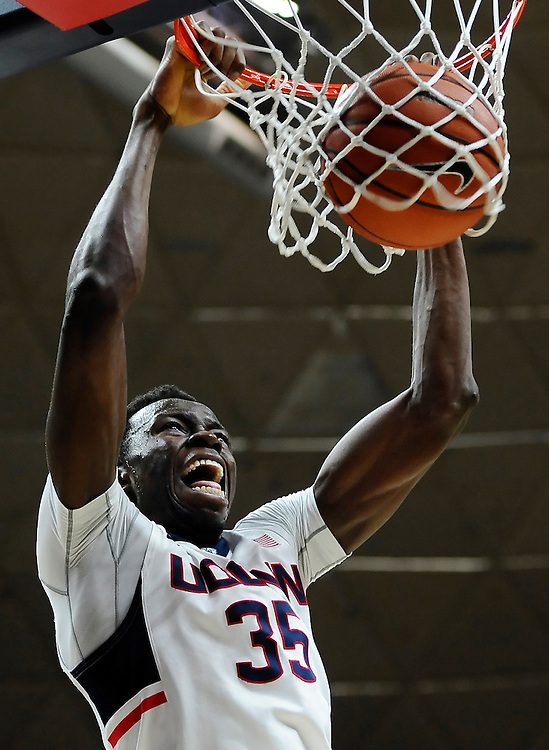 Connecticut's Amida Brimah dunks in the second half of an NCAA college basketball game against Maine, in Storrs, Conn. (AP Photo/Jessica Hill)