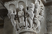 Carved capital from the narthex of Vezelay Abbey church, Vezelay, Yonne, Burgundy, France. Vezelay Abbey was a Benedictine and Cluniac monastery founded in the 9th century by St Badilo, who was said to have brought back relics of Mary Magdalene from the Holy Land. The Abbey Church or Basilica of St Mary Magdalene is a 12th century Burgundian Romanesque church. This capital depicts saints Peter and Paul resurrecting a young man. This scene is not in the gospels but is inspired by legends of the saints' travels in Rome with Simon Magus. Picture by Manuel Cohen
