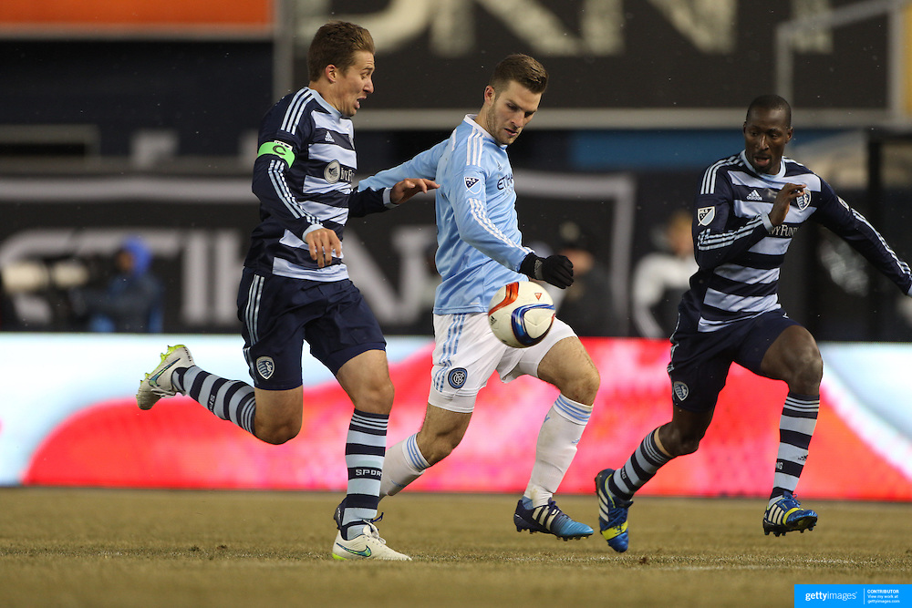Patrick Mullins, NYCFC, is challenged by Matt Besler, (left), Sporting KC, in action during the New York City FC Vs Sporting Kansas City, MSL regular season football match at Yankee Stadium, The Bronx, New York,  USA. 27th March 2015. Photo Tim Clayton
