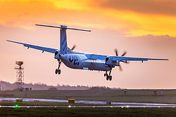 © Licensed to London News Pictures. 14/01/2020. Leeds UK. A flybe aircraft arriving from Belfast City struggles to land in strong winds at Leeds Bradford airport this morning. Flybe, Europe's largest regional airline, is scrambling to stave off a collapse that would put 2,000 jobs at risk. Photo credit: Andrew McCaren/LNP