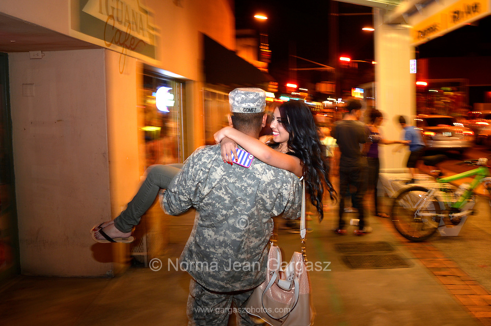 Francisco Gomez, (left), who is on leave from serving in the U.S. Army in Germany, and Paola Uzarraga stroll through the 2nd Saturdays Downtown event in Tucson, Arizona, USA.