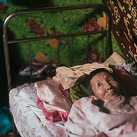 Mongolia. Uvs province, 2016.<br /> <br /> Khalzan Khash, 73, suffers from a disease which makes it impossible to work. She is being taken care of by her six children.