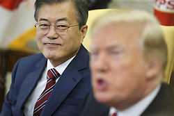 South Korean President Moon Jae-in listens as President Donald Trump speaks during a meeting in the Oval Office of the White House on May 22, 2018 in Washington DC.<br /> (Photo by Oliver Contreras/SIPA USA)