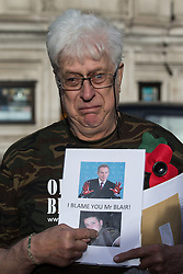 © Licensed to London News Pictures . 06/07/2016 . London , UK . DAVID GODFREY , grandfather of Daniel Coffey , killed in action , talking to TV outside . The families of those killed in the Iraq war arrive at the QEII Centre . Scene outside the Queen Elizabeth II Conference Centre in Westminster , ahead of the publication of the Chilcot Inquiry's report in to the 2003 invasion of Iraq . Photo credit : Joel Goodman/LNP