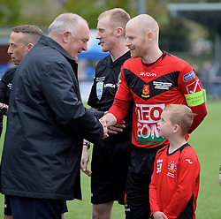NEWTOWN, WALES - Saturday, May 2, 2015: FAW President Trefor Lloyd-Hughes shakes hands with Newtown's captain Matthew Cook before the FAW Welsh Cup final match at Latham Park. (Pic by Ian Cook/Propaganda)