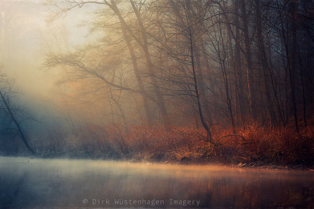 Rising fog on river Wupper/Germany on a cold morning at the end of Winter.