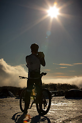 © Licensed to London News Pictures . 23/01/2019. Bolton , UK . A cyclist stops to take photos of the landscape in crisp weather in Horrocks Wood . Clear skies and snow shrouds the hills in the North West as fog descends over Manchester City Centre . Photo credit : Joel Goodman/LNP