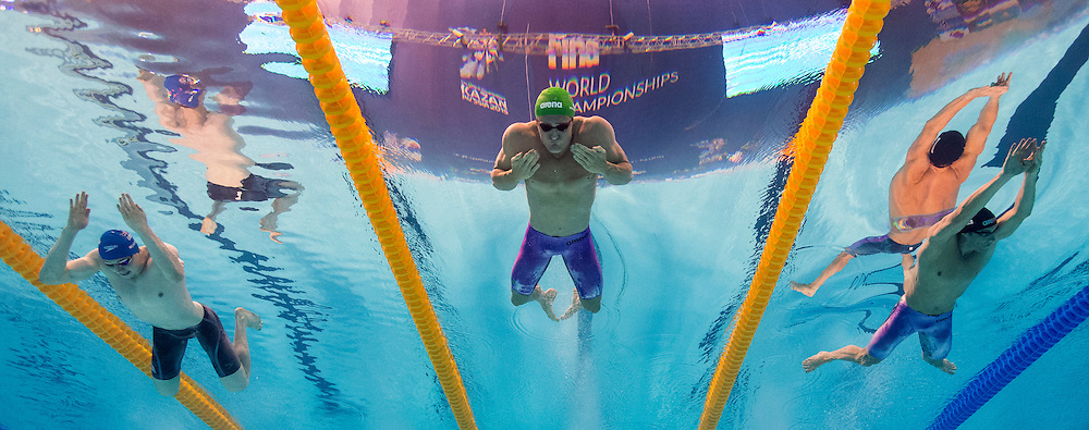 (L-R) Ross Murdoch of Great Britain, Cameron Van Der Burgh of South Africa and Hendrik Feldwehr of Germany compete in the men's 100m Breaststroke Semifinal during the 16th FINA World Swimming Championships held at the Kazan arena in Kazan, Russia, Sunday, Aug. 2, 2015. (Photo by Patrick B. Kraemer / MAGICPBK)