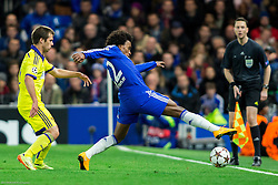 Damjan Bohar of Maribor vs Willian of Chelsea during football match between Chelsea FC and NK Maribor, SLO in Group G of Group Stage of UEFA Champions League 2014/15, on October 21, 2014 in Stamford Bridge Stadium, London, Great Britain. Photo by Vid Ponikvar / Sportida.com