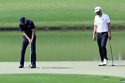 September 23, 2017 - Atlanta, Georgia, United States - Jordan Spieth putts the 8th green as Dustin Johnson looks on during the third round of the TOUR Championship at the East Lake Club. (Credit Image: © Debby Wong via ZUMA Wire)