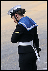 A servicewoman bows her head at Baroness Thatcher's funeral at St.Paul's Cathedral in London Wednesday 17th  April 2013 Photo by: Stephen Lock / i-Images