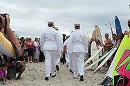 20110911 - Long Beach , NY - Members of the Navy walk down a path lined with surfers before a paddle out in remembrance of 9/11 as part of a beach mass and ecumenical service at National Boulevard Beach.  .Photo by Isabel Slepoy / LI Herald