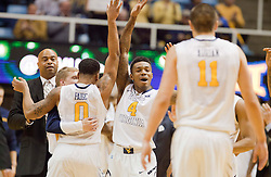 West Virginia Mountaineers guard Daxter Miles Jr. (4) celebrates with teammates after a timeout against the Wofford terriers during the first half at the WVU Coliseum.