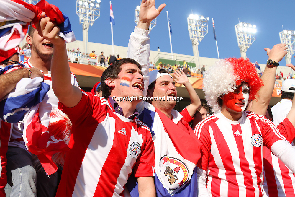 Fans celebrate during the the FIFA World Cup 2010 match between New Zealand and Paraguay held at The Peter Mokaba Stadium in Polokwane, South Africa on the 24th June 2010<br /> <br /> <br /> Photo by Ron Gaunt/SPORTZPICS
