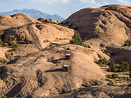 A 4x4 Hummer tour on the Hell's Revenge Trail in the Sandflats Recreation Area near Moab, Utah.