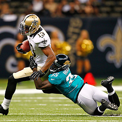 August 17, 2012; New Orleans, LA, USA; Jacksonville Jaguars cornerback Mike Harris (35) tackles New Orleans Saints wide receiver Joe Morgan (13) during the second half of a preseason game at the Mercedes-Benz Superdome. The Jaguars defeated the Saints 27-24.  Mandatory Credit: Derick E. Hingle-US PRESSWIRE