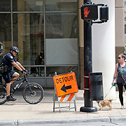 A City of Orlando bicycle police officer patrols the downtown sector on Monday, March 30, 2020 in Orlando, Florida. (Alex Menendez via AP)