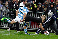 New Zealand's Damian McKenzie, right, dives over the line to score as Argentina's Santiago Cordero runs behind in the Investic Rugby Championship Test match at Yarrow Stadium, New Plymouth, New Zealand, Saturday, September 09, 2017. Credit:SNPA / Dean Pemberton  **NO ARCHIVING**