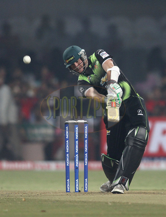 Jon-Jon Smuts of the Warriors hits over the top for six during match 1 of the NOKIA Champions League T20 ( CLT20 )between the Royal Challengers Bangalore and the Warriors held at the  M.Chinnaswamy Stadium in Bangalore , Karnataka, India on the 23rd September 2011..Photo by Shaun Roy/BCCI/SPORTZPICS