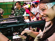 "14 JANUARY 2017 - BANGKOK, THAILAND: Thai children shoot bb guns modeled on the M16 assault rifle during Children's Day activities at the King's Guard, 2nd Cavalry Division base in Bangkok. Thailand National Children's Day is celebrated on the second Saturday in January. Known as ""Wan Dek"" in Thailand, Children's Day is celebrated to give children the opportunity to have fun and to create awareness about their significant role towards the development of the country. Many government offices open to tours and military bases hold special children's day events. It was established as a holiday in 1955.        PHOTO BY JACK KURTZ"