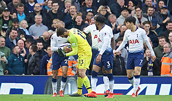 LIVERPOOL, ENGLAND - Sunday, March 31, 2019: Liverpool's goalkeeper Alisson Becker tries to take the ball off Lucas Moura after the first equalising goal during the FA Premier League match between Liverpool FC and Tottenham Hotspur FC at Anfield. (Pic by David Rawcliffe/Propaganda)