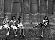 Three girls and a boy eating ice cream by the Santa Maria del Mar, Barcelona. Editorial use only, not model released.