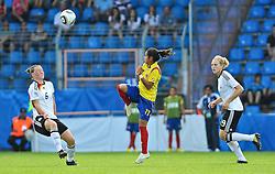 16.07.2010, Ruhrstadion, Bochum, GER, FIFA U-20 Frauen Worldcup, Deutschland vs Kolumbien, im Bild vl. Marina HEGERING (FCR Duisburg #6), Liana SALAZAR (Liga Bogota COL #11), Kim KULIG (Hamburger SV #19), EXPA Pictures © 2010, PhotoCredit: EXPA/ nph/  Roth / SPORTIDA PHOTO AGENCY