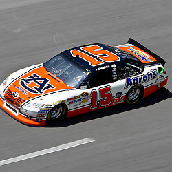 April 17, 2011; Talladega, AL, USA; NASCAR Sprint Cup Series driver Michael Waltrip (15) drives Auburn color schemed car during the Aarons 499 at Talladega Superspeedway.   Mandatory Credit: Derick E. Hingle
