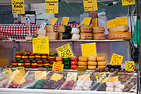 A cheese shop in the de Pijp neighborhood of Amsterdam sells a large variety of cheese, especially Dutch gouda.