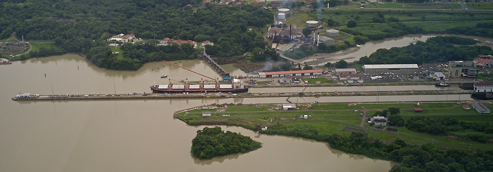 Container ship at Miraflores Lock. Panama Canal.