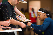 Odyssey Sims of the Dallas Wings signs autographs for fans before tipoff against the Connecticut Sun during a WNBA preseason game in Arlington, Texas on May 8, 2016.  (Cooper Neill for The New York Times)