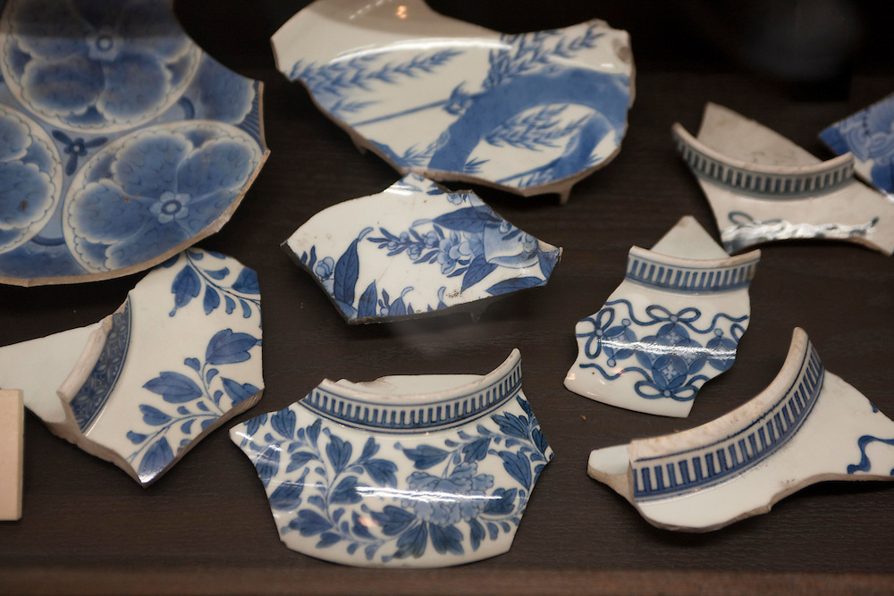 Arita.shots around Arita and samples of various types of ceramics. these chards are all that is left of a samurai's clan Atria ware as it was defeated and it property was destroyed by its enemies. the  comb design on the  base is only allowed to be used in ceramics made for samurai clans who had there own designs created..