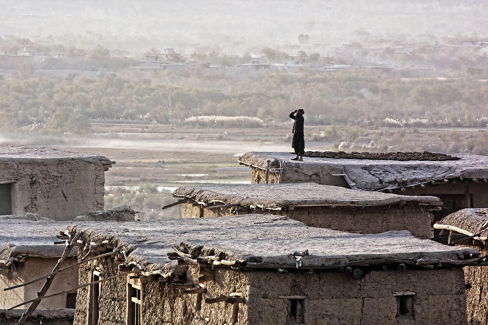 20011029-CAPISO PROVINCE, AFGHANISTAN: The resident of unidentified village in Capiso province near the Kuyoton montain watches the strikes of the US bombers on the Taliban positions about 1km from this village, 29 October, 2001.