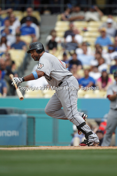 LOS ANGELES - JUNE 19:  Carlos Lee #45 of the Houston Astros watches the ball as he runs to first base after making contact with a pitch during the game against the Los Angeles Dodgers at Dodger Stadium on Sunday, June 19, 2011 in Los Angeles, California.  The Dodgers defeated the Astros 1-0.  (Photo by Paul Spinelli/MLB Photos via Getty Images) *** Local Caption *** Carlos Lee