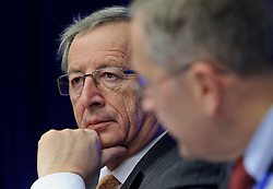 Jean-Claude Juncker, Luxembourg's prime minister, and president of the Eurogroup, left, listens during a joint press conference with Klaus Regling, chief executive officer of the European Financial Stability Fund (EFSF), following the Eurogroup meeting in Brussels, Monday Dec. 6, 2010.  (Photo © Jock Fistick).