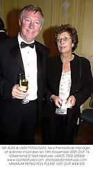 SIR ALEX & LADY FERGUSON, he is the football manager, at a dinner in London on 14th November 2001.	OUF 16