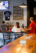 Guests sit at the bar of Bentonville Brewing Company on Friday, February 19, 2016, in Bentonville, Arkansas. Beth Hall for the New York Times