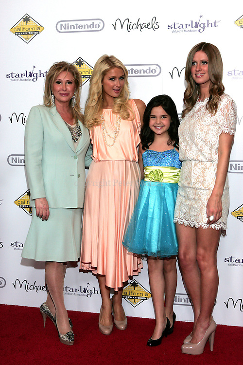 "Paris and Nicky Hilton arrive with Mom and Dad on the red carpet at ""A Stellar Night"" hosted by ""Starlight Children's Foundation"" who are brightening the lives of seriously and terminally ill children in order to take their minds off the pain, fear and isolation of their illness. The Gala benefit was held at the Century Plaza Hyatt Hotel in Century City Ca. Saturday March 26, 2011. Photo by Peter Switzer"