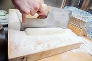 Takayoshi Kawai, 37, is cutting soba dough. The Sarashina Horii Noodle Restaurant in Tokyo, Japan.
