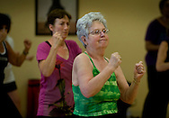 On her 80th birthday Colleen Schell goes through a punching exercise during the Jazzercise workout class. Jazzercise has turned 40. But, gosh, it doesn't look a day over 39. Must be all that aerobic work. We took at the fitness regimen that has endured in an era where fads come and go. We'll be featuring a Land Park jazzercise studio that's been catering to women (and a few men) for 21 years. September 25, 2009.