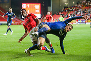 Nottingham Forest defender Joe Worrall (4) collides with Charlton Athletic midfielder Chuks Aneke (10) during the EFL Sky Bet Championship match between Charlton Athletic and Nottingham Forest at The Valley, London, England on 21 August 2019.