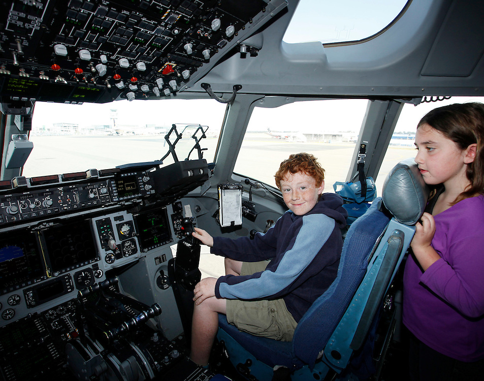Children visiting the cockpit of the US Air Force C-17 Globemaster at an open day in Christchurch for the start of the 2011/2012 Antarctic Season, Christchurch, New Zealand, Saturday, October 1, 2011.  Credit:SNPA / Pam Johnson