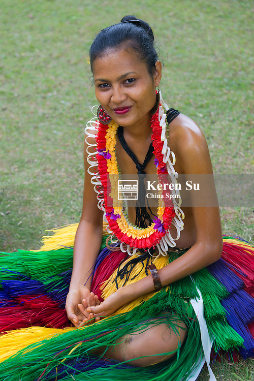 Yapese girl wearing flower lei and grass skirt at Yap Day Festival, Yap Island, Federated States of Micronesia